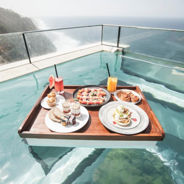 Floating breakfast at the theedgebali with a glass bottom floor